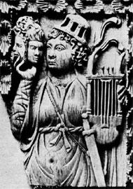 Θεατρίνα που κρατά τρεις μάσκες και λύρα. Ελεφαντοστό από τα Τρέβιρα, αρχές 6ου αι., Βερολίνο.