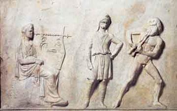Μουσικός διαγωνισμός του Απόλλωνα με τον Μαρσύα. Μαρμάρινη βάση από τη Μαντίνεια, περ. 330 π.Χ. Αθήνα, Εθν. Αρχαιολογικό Μουσείο