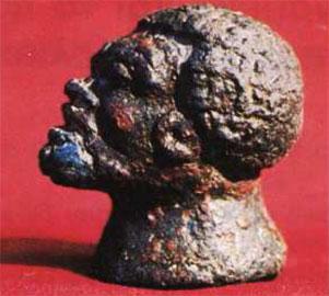 Μπρούτζινο βαρίδιο σε σχήμα κεφαλής Αφρικανού.