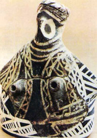 Γυναικόμορφο αγγείο από τα Μάλια ( P. Demargne, Γέννηση της ελληνικής τέχνης).