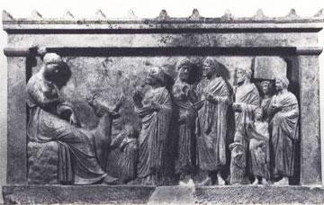 Αναθηματικό ανάγλυφο που εικονίζει τη θεά Άρτεμη καθιστή σε βράχο να ακούει τους ικέτες.