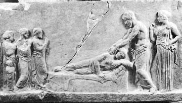 Ανάγλυφο από το Ασκληπιείο Πειραιά, αρχές 4ου αι. π.Χ. Θεραπεία ασθενούς από τον Ασκληπιό. Πίσω του η Υγεία. Μουσείο Πειραιώς.