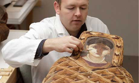 The Ashmolean's paintings conservator, Jevon Thistlewood, puts the finishing touches to his restoration of the mummy portrait of woman dating back to 55-70AD.