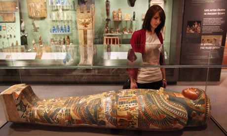 A woman views the mummy of Meresamun, a female singer, in the Ashmolean Museum's new exhibition of artifacts from ancient Egypt and Nubia.
