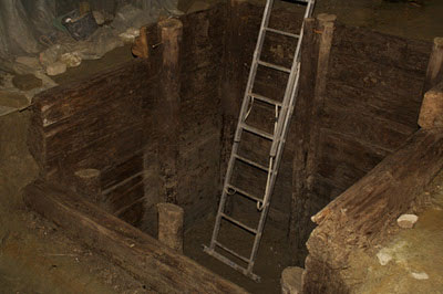The wooden latrine from the 13th century, where the 11th-century ceramic shard was found.