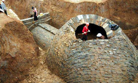 Workers excavate a 1,700-year old brick tomb in China's Jiangsu province. But often thieves get there first, sometimes just bulldozing their way in.