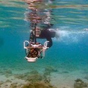 Student takes award for revealing submerged city's secrets