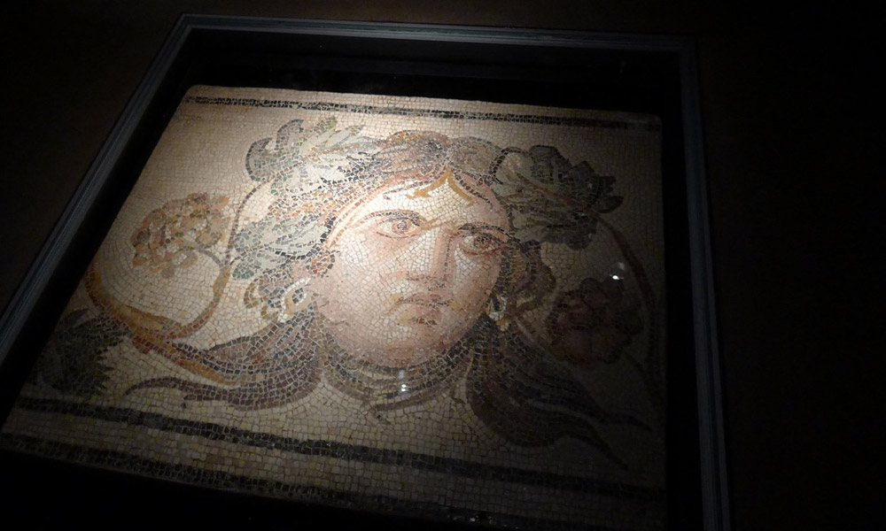 The ancient Roman mosaics at BGSU have been installed below glass in a lobby at the new Wolfe Arts Center.