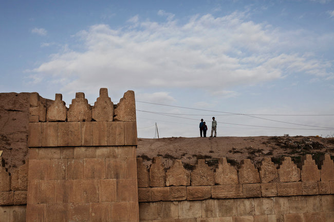 Children standing on a wall dating to ancient Nineveh.