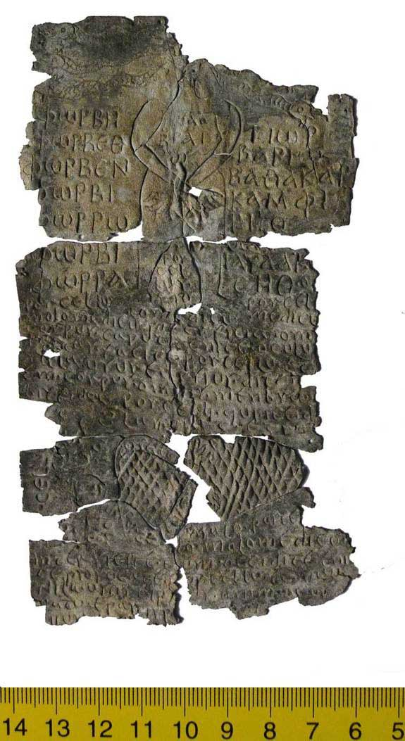 This curse tablet targets a veterinarian named Porcello. At top is a deity with snakes coming out of its head and an eight figured sign on its genitals.