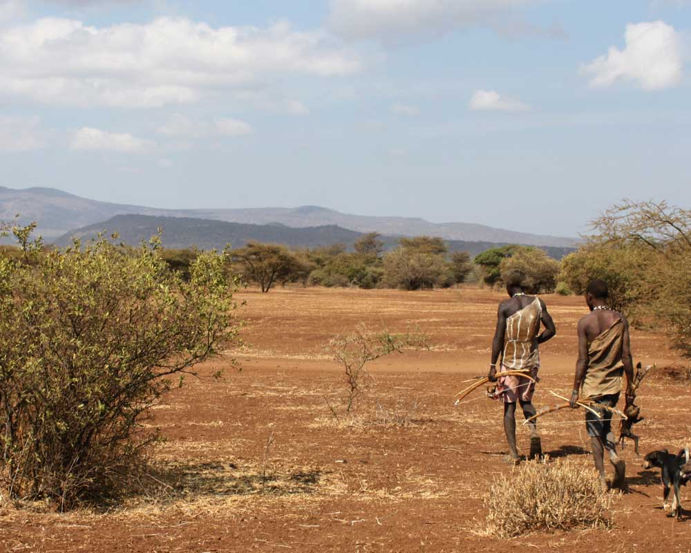 Hadza hunters in Tanzania. The skills need to kill animals for food have now been dated back to two million years ago.