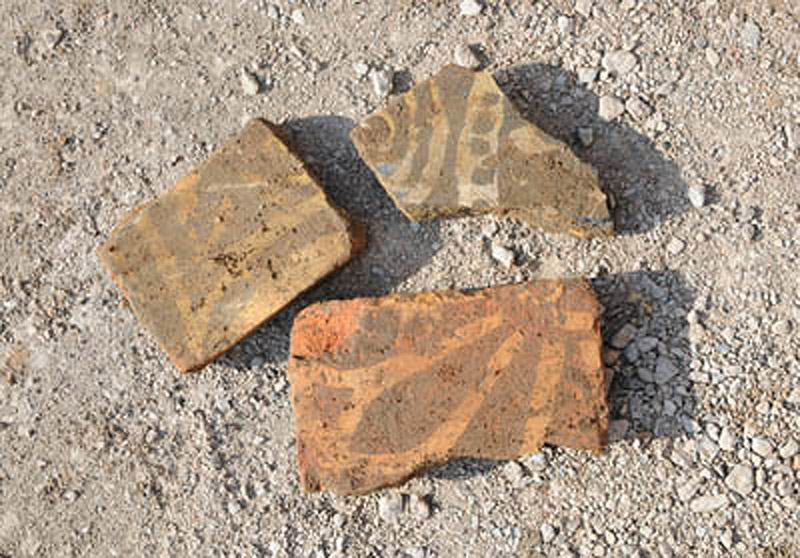 Glazed floor tile fragments found among the ruins of the Church of the Grey Friars, Leicester, UK.