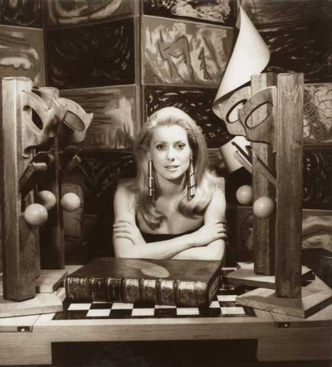 Catherine Deneuve was photographed in 1968 for a Sunday newspaper in an image which heavily references Man Ray. The screen in the background was painted by him, and the distinctive earrings she wears are also his design.