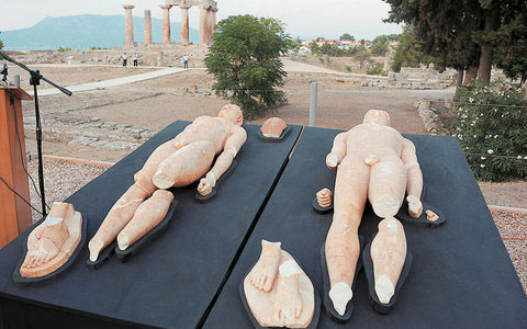 The two marble kouroi dating to the 6th century BC have been recovered in a police raid near Corinth in May 2010.