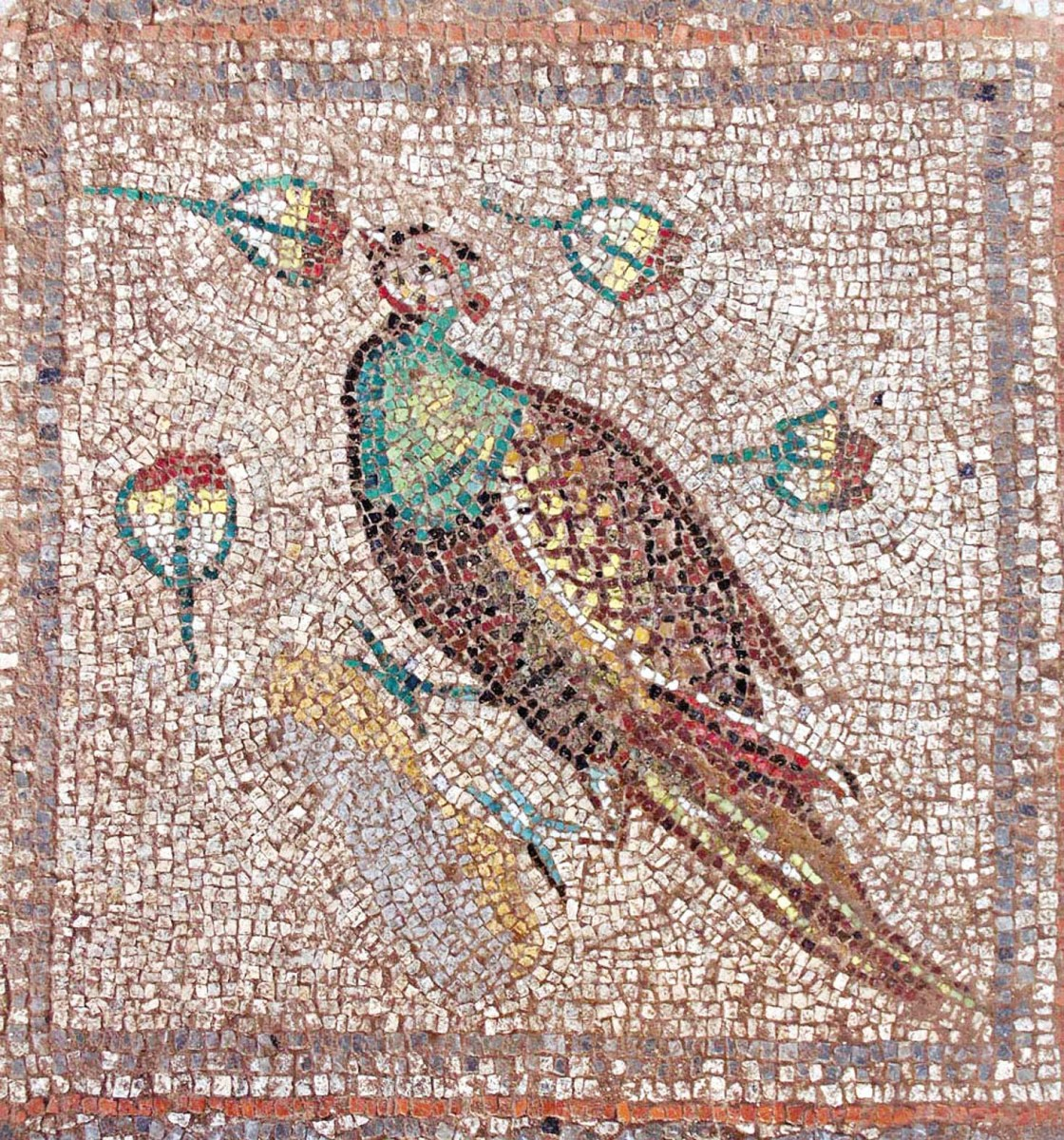 The mosaics are decorated with natural stones. You can see various shades of red, blue and green.