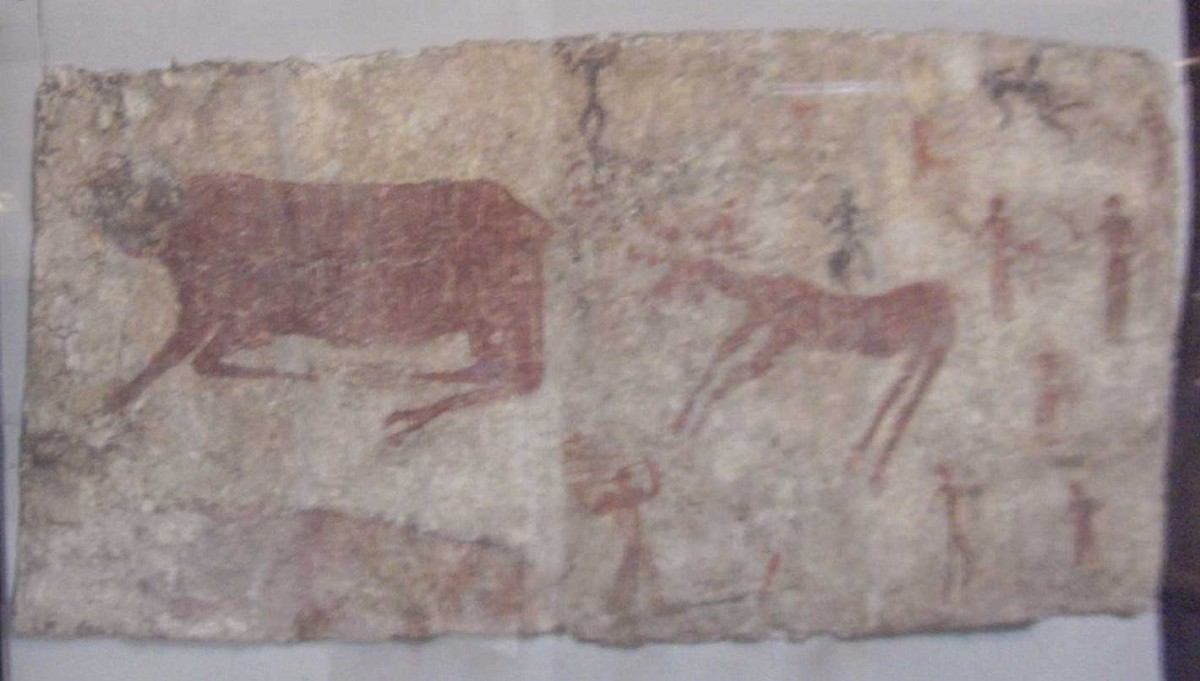 Wall painting of a bull, deer and man from Çatalhöyük, 6th millennium BC. Reconstruction of the bull's heads and the human relief-figure. Museum of Anatolian Civilizations, Ankara, Turkey.