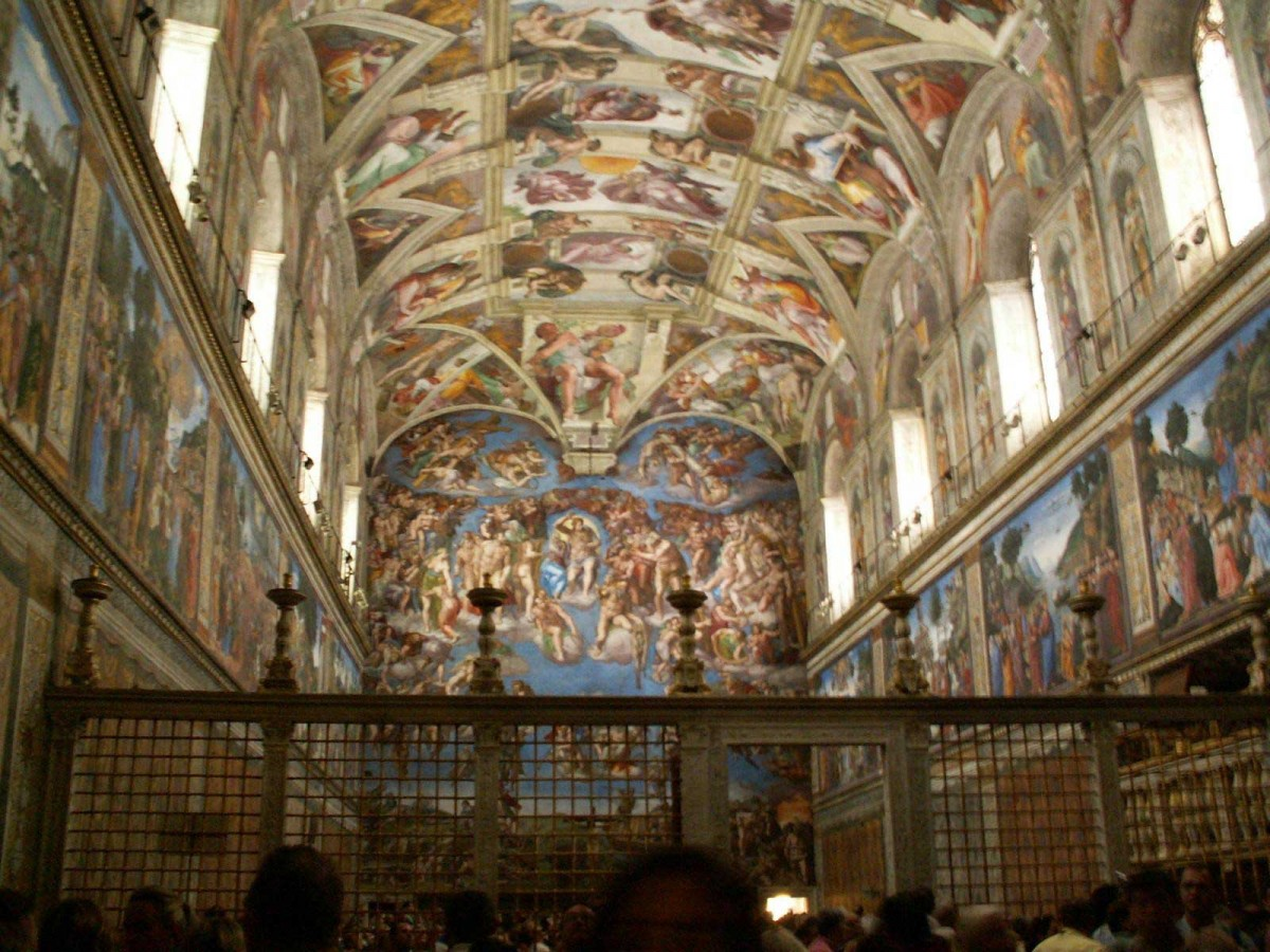 The Sistine Chapel packed with tourists. On the far wall