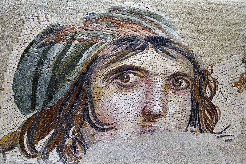 Fig. 1. Extraordinary Roman mosaics such as this image of a girl or perhaps a goddess once decorated wealthy houses in Zeugma in southern Turkey. (Sites & Photos/Art Resource)