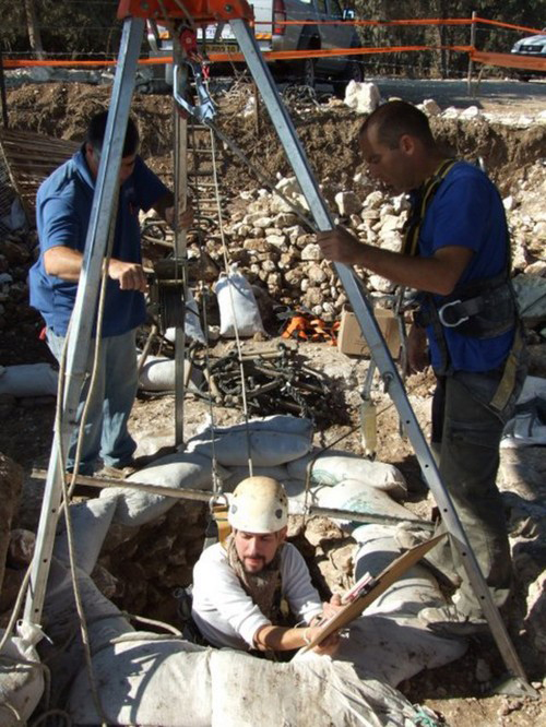 Archaeologists working at a Stone-Age well used by the first farmers in Israel's Jezreel Valley.