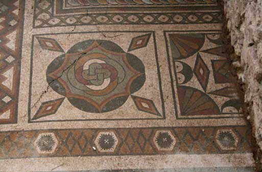Geometric motifs and symbols are the dominant features of the mosaic floor that is part of the Roman triclinium at ancient Plotinopolis.