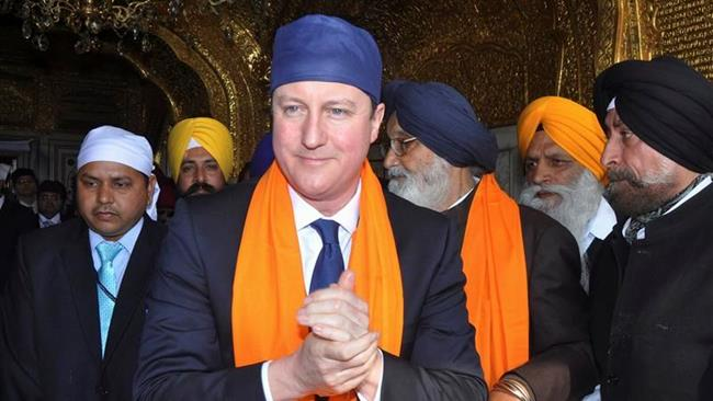 """British Prime Minister David Cameron shown here visiting the Golden Temple in Amritsar, India, says he does not """"believe in 'returnism'"""", referring to British possession of both the 105 carat Koh-i-Noor diamond and the Elgin marbles."""