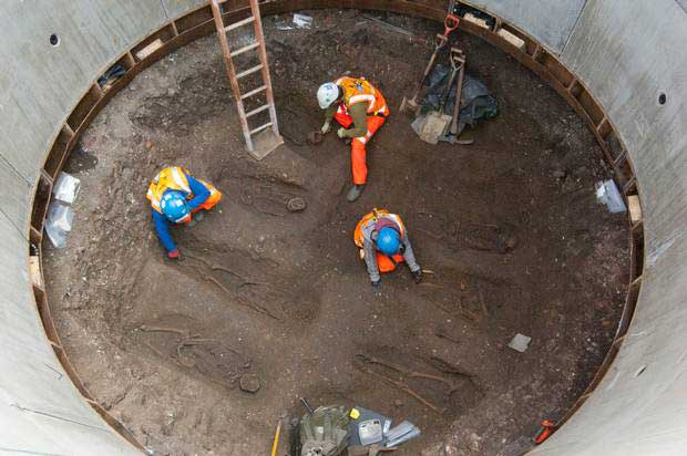 Delicate work: archaeologists under Charterhouse Square.