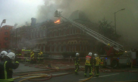 Firefighters at the scene of the fire that damaged the Cuming Museum. Photograph: London Fire Brigade/Demotix/Corbis.