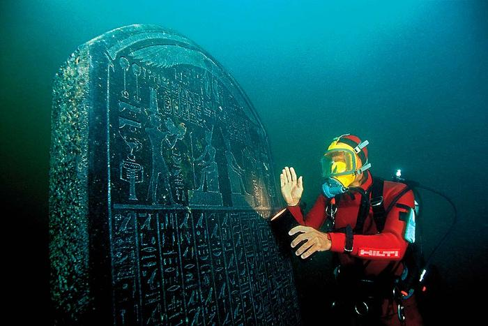 Franck Goddio with a stele found on Heracleion's sea-bed and mentioning the city's name in Greek and Egyptian.
