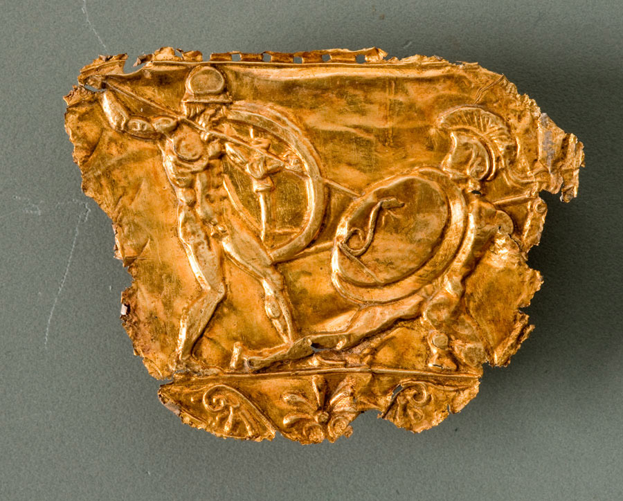 Gold shield decoration fragment showing warriors. Found at Aigai.