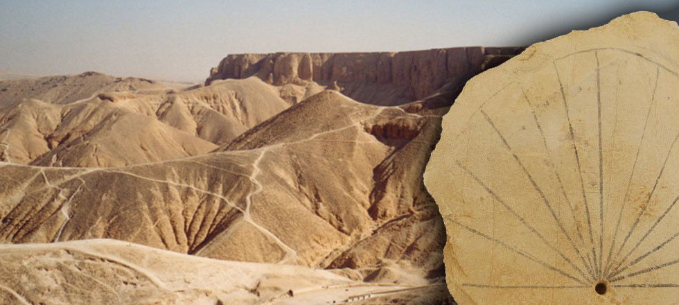 The sun-dial ostracon and the Valley of the Kings in the background.