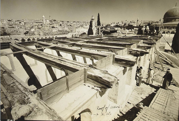 Removing cedar beams during the early 20th century restoration at Al-Aqsa Mosque.