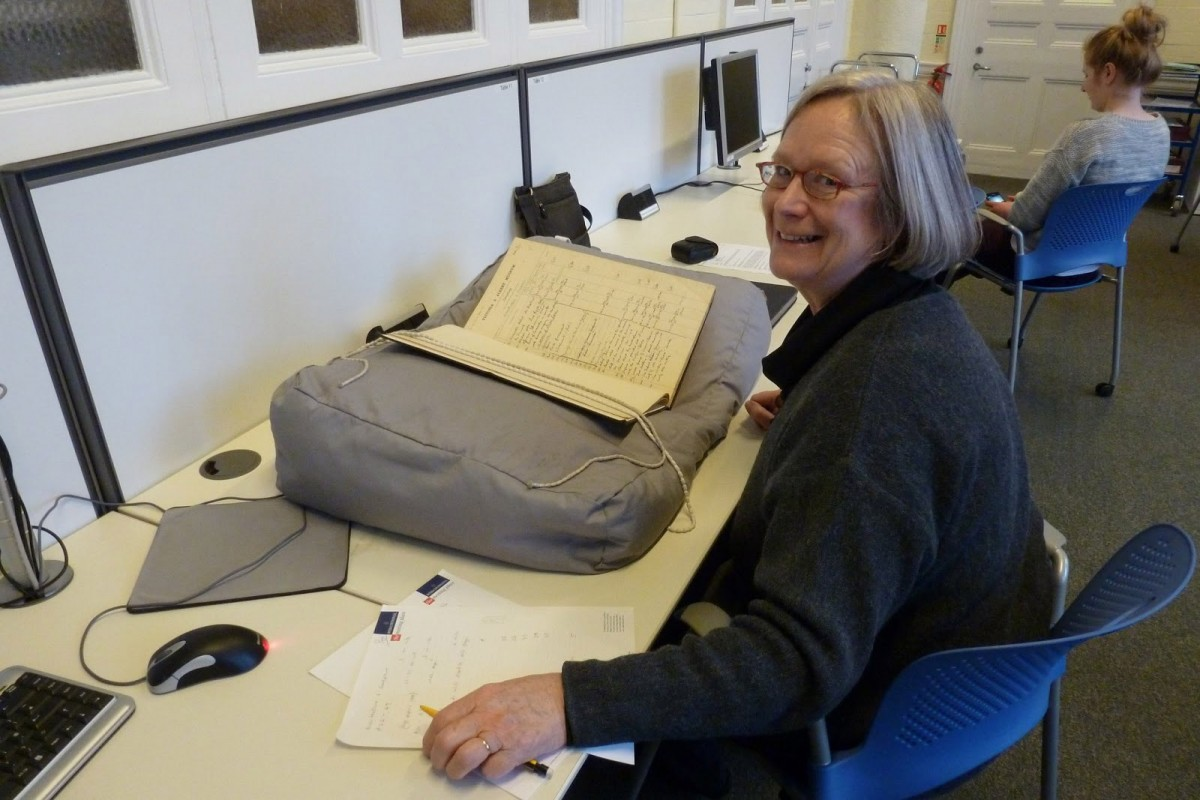 Researcher Rosalind Haddon checking archival material at the Victoria &Albert Museum.