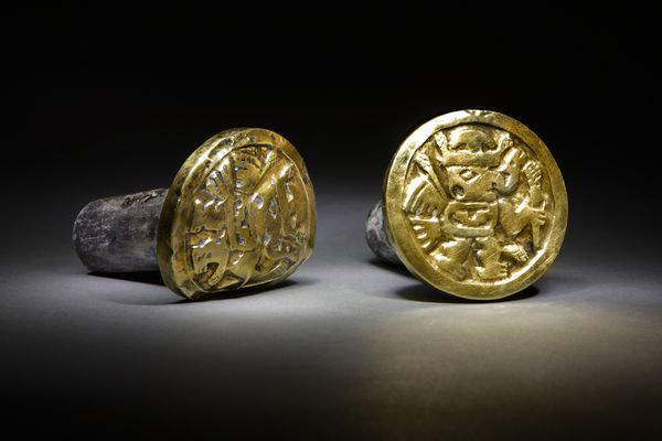 Gold and silver ear ornaments, 700-1000 AD, Wari culture, El Castillo de Huarmey, Peru. Source: National Geographic.