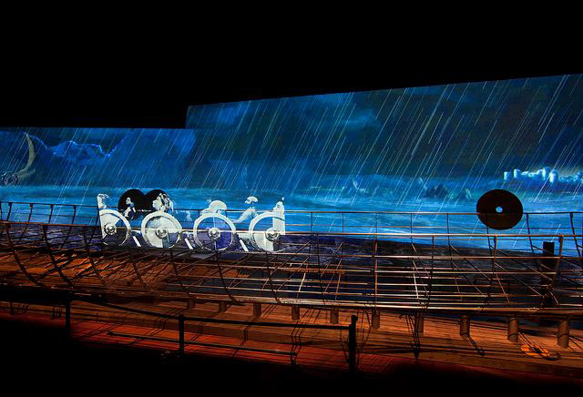 A violent animated backdrop to a reconstructed Viking warship.