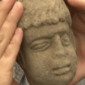 Carved head of Roman god found in ancient rubbish dump