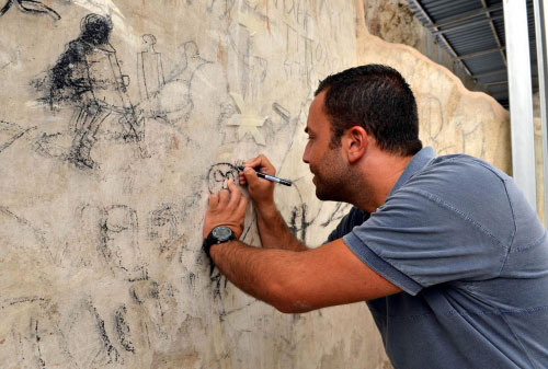 Expert working on the wall paintings on the walls of the basilica in the Agora of Izmir.