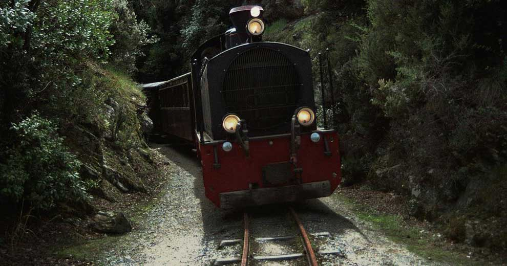 "This 60 cm gauge line, one of the narrowest in the world, hosts the engine and the 4 cars of ""Moutzouris"", a nickname which is used in Greek for someone who turns things black."