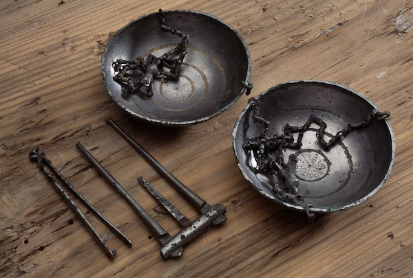 A silver button and a set of balance scales found at Lø, near Trondheim, Norway (ca 1000 AD).