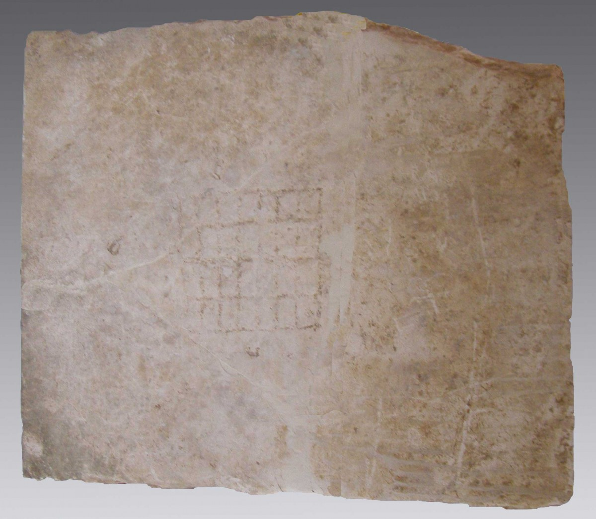 Limestone slab with engraved game. Archaeological Museum of Arta.