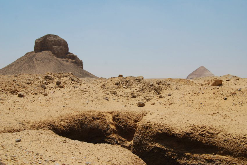 Close to Dahshur's  Black Pyramid, dozens of tombs lie open. Mounds of earth signal the location of the excavation.