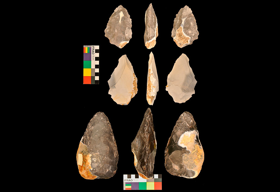 Three hand axes produced by participants in the experiment. Front, back and side views are shown. Photo: University of Liverpool.