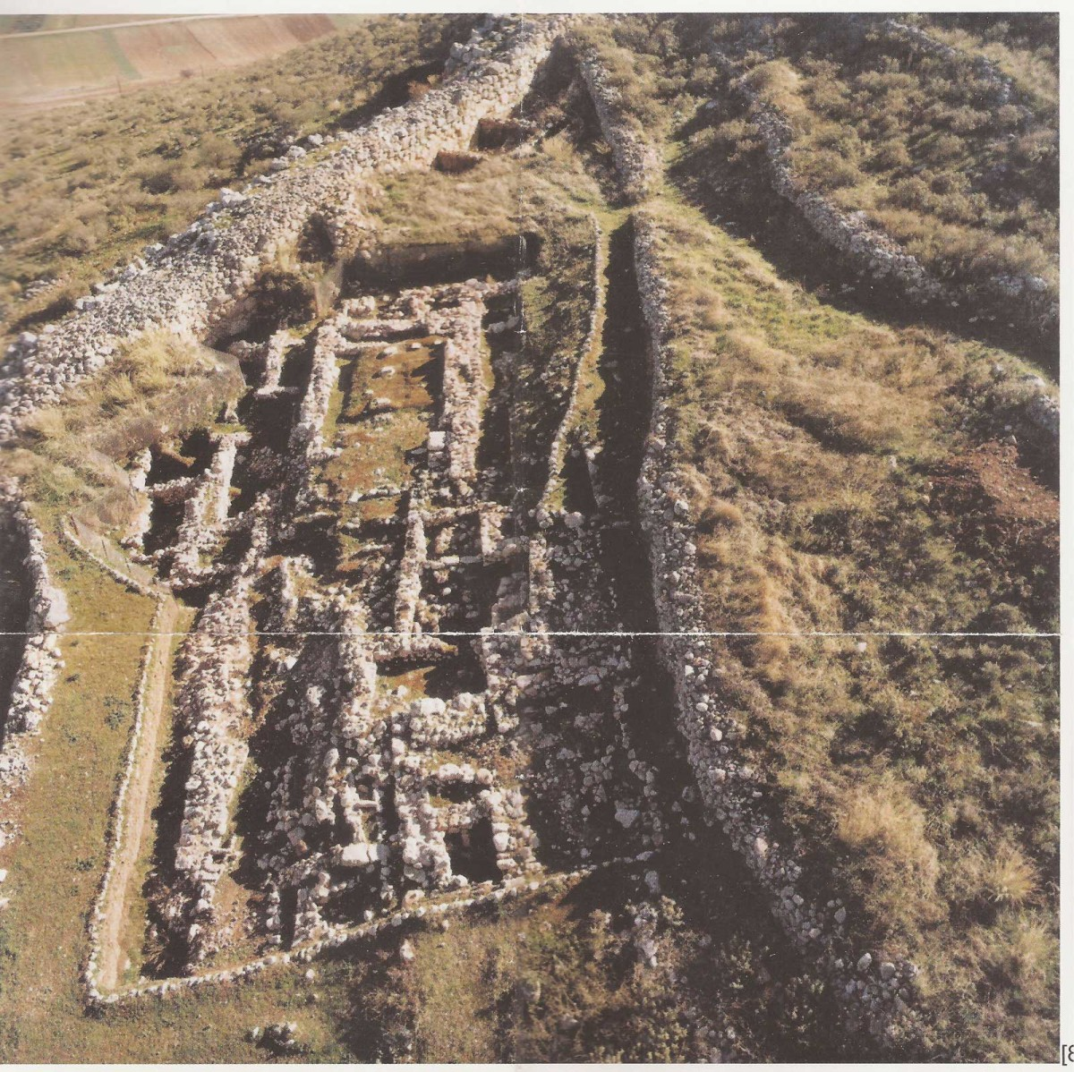 """On the lower northeast terraces of the Acropolis was found a complex of buildings, the most important of which is a large rectangular construction in the form of a """"megaron""""."""