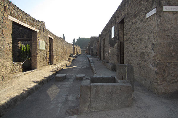 Those narrow, two-way stone streets would have been noisy and odoriferous, filled with donkey carts, human sewage and animal feces, with slaves carrying the wealthy elite above the mob on litters...