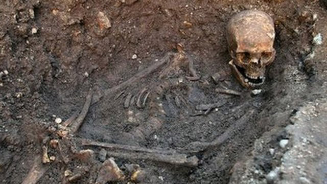 The burial site of Richard III with the skeleton in situ.