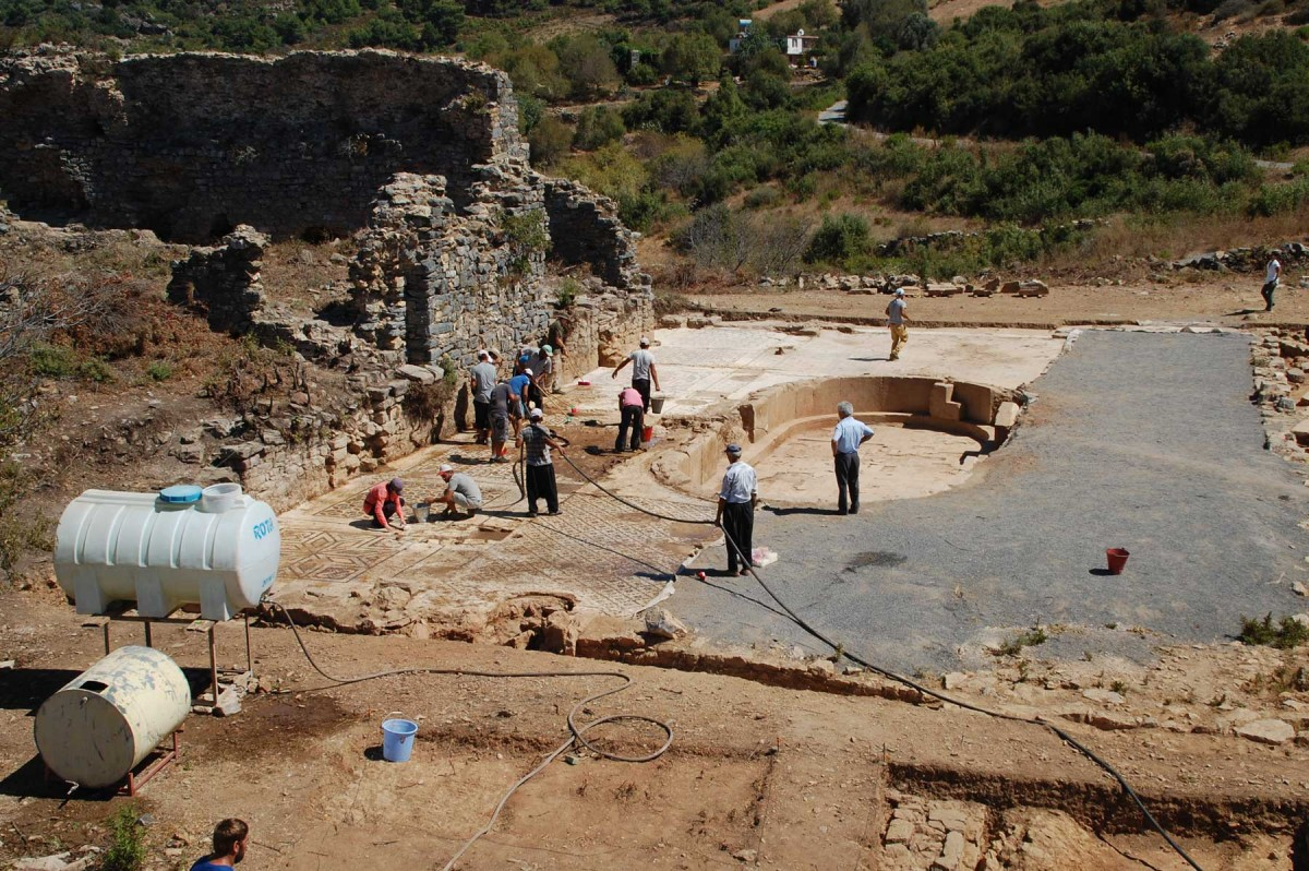 Members of a UNL-led archeology team uncover the western portion of a 1,600-square-foot mosaic in southern Turkey. (Michael Hoff, UNL)