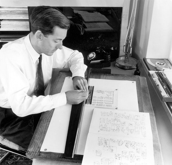 Michael Ventris maps out a table of signs that would aid him in deciphering Linear B. Drawing on the work of the scholars E.L. Bennett, Jr., and A. Kober, Ventris was able to prove that Linear B was used to record the Greek language. Photo credit:Tom Blau/Camera Press