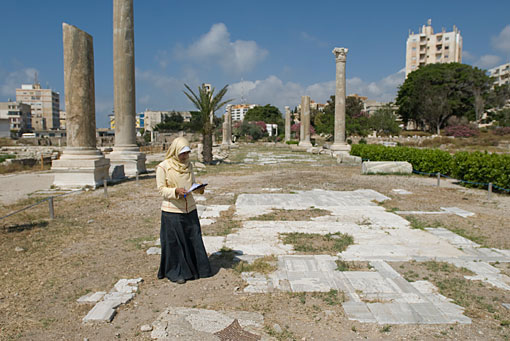 A participant examines the condition of a mosaic pavement as part of the 2010 course in Tyre (Lebanon). Photo: Leslie Friedman.