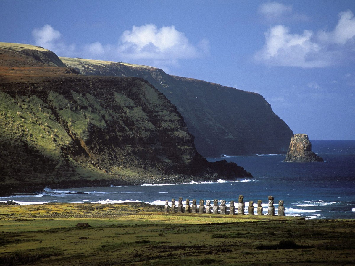 An Easter Island beach, complete with a series of Moai facing inlands.