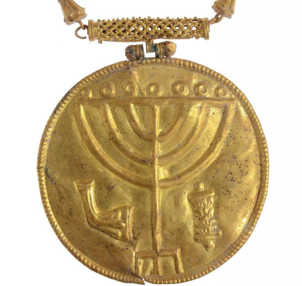 Gold medallion bearing a Temple menorah, shofar and Torah scroll. Temple Mount, Jerusalem. 7th century AD.