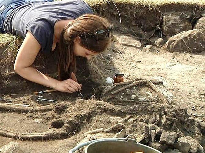 Revealing a skeleton in Sandby fort, Sweden.